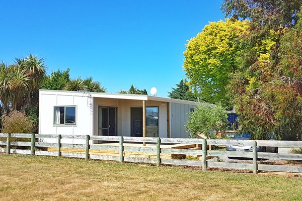 Our spacious apartment has great views over the neighbouring reserve to the Martinborough Hills.